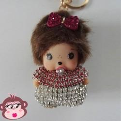 Bijou de sac Oh My Monkey avec noeud rouge